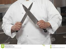 sharpening kitchen knives with a chef sharpening knives in commercial kitchen stock photo image