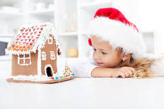 my christmas happy kids with gingerbread house at christmas royalty free stock