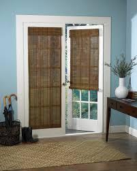 dark brown woven bamboo shades on white french doors plus dark
