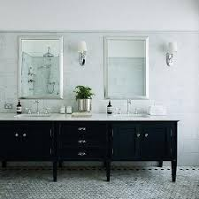 black vanity with black and white hex tile floor transitional