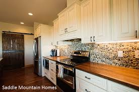 kitchen counters and backsplashes kitchen backsplash trends pebble tiles wood counter and soapstone