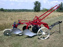 a two bottom mccormick deering little genius plow with 14 inch
