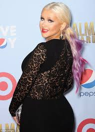 christina aguilera squeezes her curves into an unflattering tight