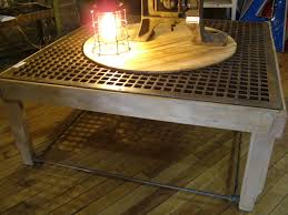 coffee table made from cast iron floor grate surround