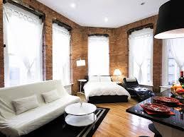 rustic one bedroom apartment white sofas black area rug brick