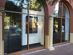 glass door for business galleria arte fino open for business at town square breslin builders