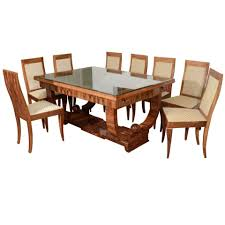 french art deco walnut dining set with eight chairs french art