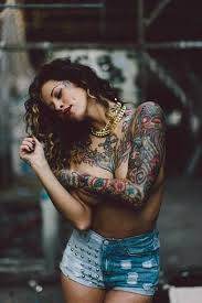 female traditional tattoos on chest and sleeves