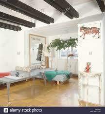 woodblock flooring and black ceiling beams in small loft