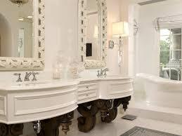 bathroom baseboards chandelier crown molding double sinks baseboards chandelier crown molding double sinks lighting floor tile freestanding bathtub mosaic tile neutral colors mirror double vanity roman shades rug