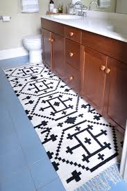 Small Rugs For Bathroom How To Sew Two Small Rugs Together To Make A Custom Runner The