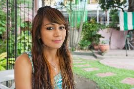 hairstyle in the philippines portrait of beautiful young woman smiling outdoors manila