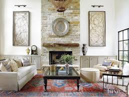 mediterranean white living room limestone fireplace luxe