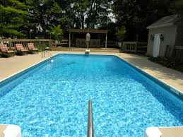 modern home with simple rectangle dark blue lap pool small dipping