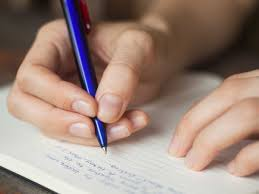 writing a good reflection paper tips to improve handwriting business insider make sure your grip isn t too tight and steady your page with your non dominant writing hand shutterstock
