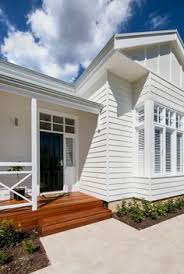 love the blue grey weatherboard white railings verandah coastal