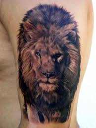 small lion head tattoo on back for women