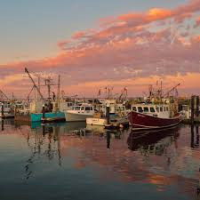 fishing boats and clouds provincetown cape cod sunset on july 3