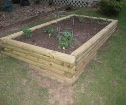 Retaining Wall Garden Bed by Landscape Timber Garden