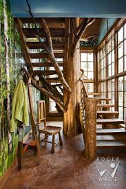 log home photographer cabin images log home photos roger wade studio interior design photography of tree trunk stairway in luxury handcrafted log home roger wade studio architectural