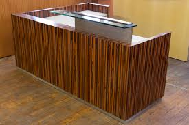 Custom Low Profile Tiger Wood Reception Desk From The Feature Film