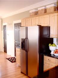 Molding On Kitchen Cabinets The Yellow Cape Cod Making Cabinets Taller Builder Cabinets Go