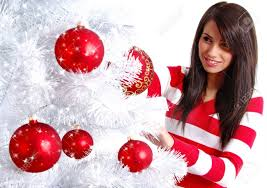 young woman decorating white christmas tree stock photo picture