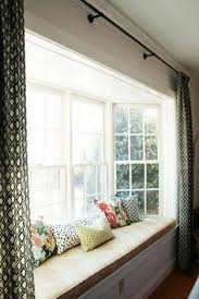 bay window seat with pillows panels and chair slipcover window