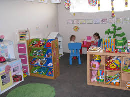 the idea of a kids playroom with a neat bookshelf on baby decor