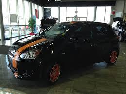 perfect for halloween this orange and black mitsubishi mirage was