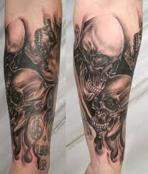 3d skull in black on leg piercings ink