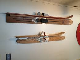 lake girl paints red and white striped water ski with mason jar vintage water skis as shelves lake house decorating
