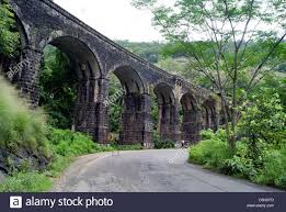 eastern and western ghats 13 pillar old railway bridge on kollam shenkottai railways line