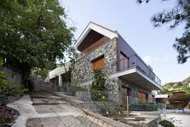 stone and irokko wood shaping a home in picturesque cyprus village