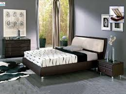 brown and blue bedroom color schemes vertical wooden paneling