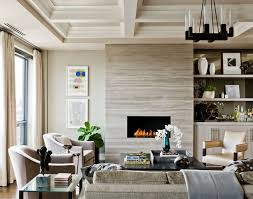 stone slab fireplace cladding and built ins to one side coffered ceiling contemporary living room by terrat elms interior design built ins