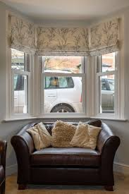 best 25 bay window curtains ideas on pinterest bay window three roman blinds to dress a bay window the fabric is by laura ashley pussy