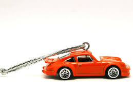 porsche with christmas tree 24 car christmas ornaments to make your tree rule the drive