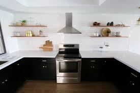 black kitchen cabinets with white subway tile backsplash bring out the of cabinets the corner cabinet