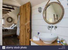 nautical mirror bathroom painted white wooden planks and nautical style mirror in ensuite