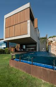 this home of concrete and wood overlooks the aegean sea contemporist
