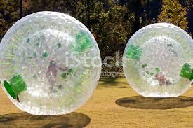 rolling inside large plastic balls stock photo 137163761 istock