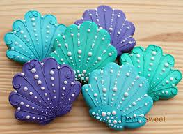 seashell shaped cookies sea shell decorated sugar cookies royal icing blue green
