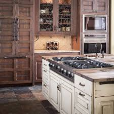 concrete countertops distressed white kitchen cabinets lighting