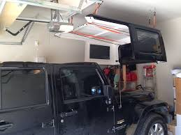how to store jeep wrangler top cheap and easy top hoist jkowners com jeep wrangler jk