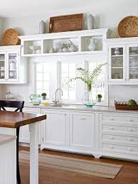 Decorating The Top Of Kitchen Cabinets by The 25 Best Above Cabinet Decor Ideas On Pinterest Above