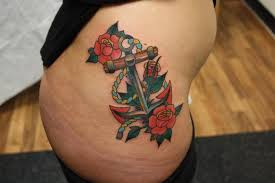 amazing anchor symbol with flowers tattoo all tattoos for men