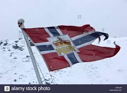 norwegian post flag flying on stern of hurtigruten coastal ship