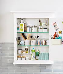 how to organize small bathroom cabinets 19 clever ways to organize bathroom cabinets better homes