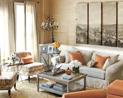 10 ways to start decorating a room from scratch how to decorate suzanne kasler decorates this living room with accents of mandarin orange